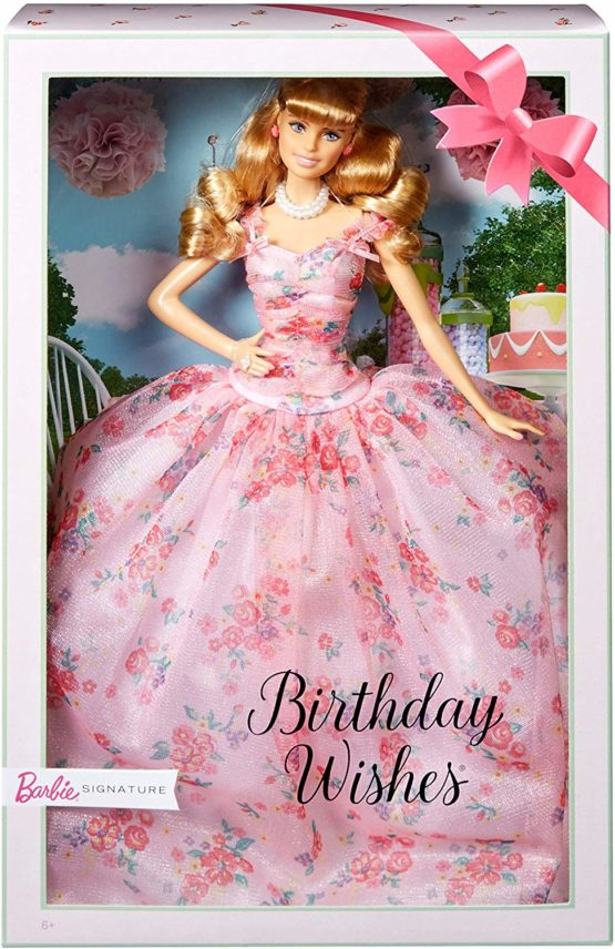 """""""• Brand: Barbie • Material: Plastic • Size: 10 inch • Birthday Wishes Barbie doll is excited to join your celebration! • Barbie doll wears a festive pink gown with a floral overlay and sweet details, like ruching at the bodice, ruffled sleeves and bow accents. • To finish the look, Barbie doll wears rosy earrings and an elegant """"""""pearl"""""""" ring . • Packaging features space to write a personalized message or birthday wish, making Birthday Wishes Barbie doll the ideal gift. • May this be your best birthday yet with Birthday Wishes Barbie doll! """""""
